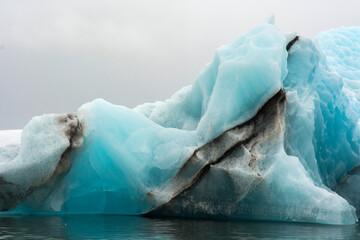 Norway. Svalbard. Spitsbergen. Hornsund. Brepollen. Iceberg with moraine dust running through it.