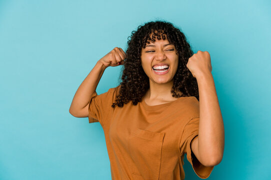 Young african american afro woman isolated raising fist after a victory, winner concept.