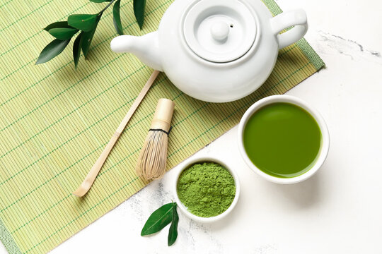 Composition with matcha tea on light background