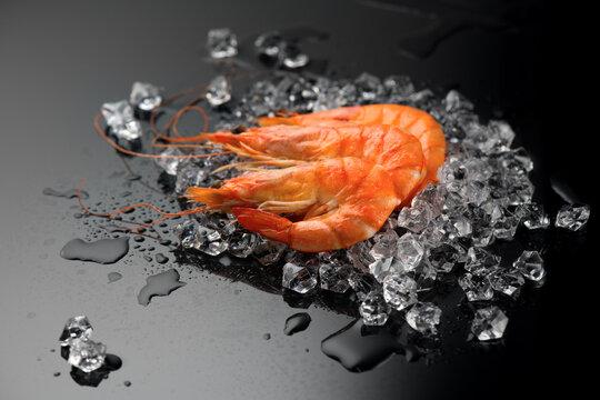 Shrimps. Fresh Prawns on a Black Background. Seafood on crashed ice, dark background, preparing healthy food, cooking, diet, nutrition concept. Served food, preparing healthy food, cooking, diet