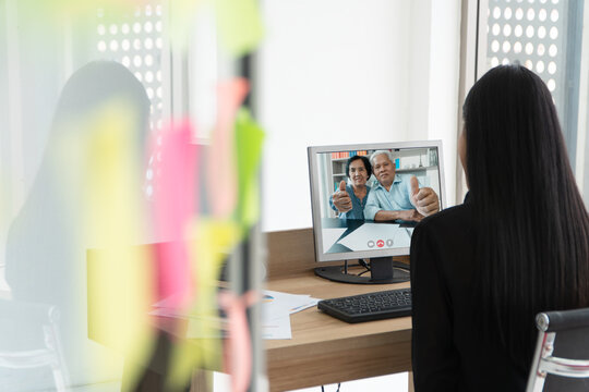 Asian parents are video conference with daughter during vacation. Concept of communication technology