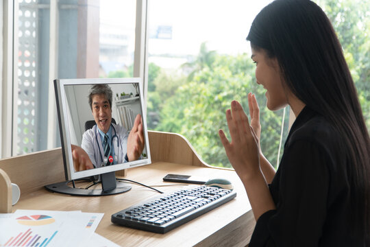Asian doctor or therapist help relieve stress and provide knowledge and understanding about office syndrome to patients video conference call online live talk remotely at home