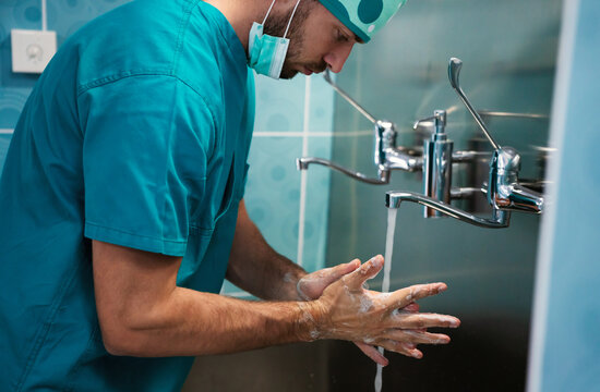 Man surgeon washing his hands at the hospital. Healthcare and medicine concept