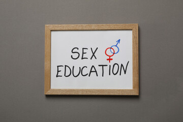 Chalkboard with text Sex Education on gray background