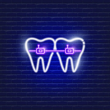 Teeth with self-ligating braces neon icon. Orthodontics concept. Sign for dentistry clinic.