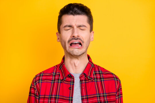 Photo of young handsome unhappy upset sad stressed depressed lonely man crying isolated on yellow color background