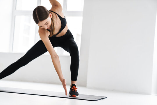 Athletic young sportswoman doing exercise while working out