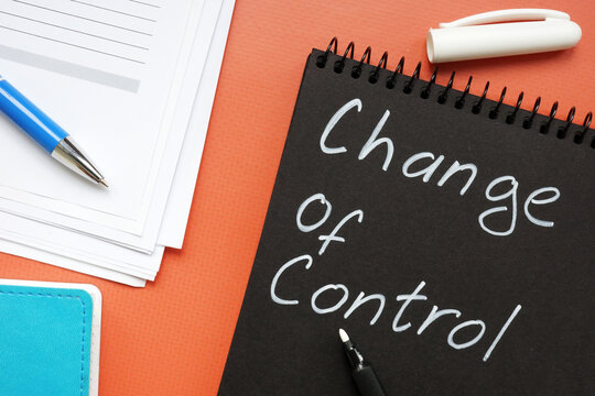Change of control phrase on the black notepad. Management concept.