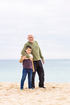 Little boy and his grandfather spending time on the beach