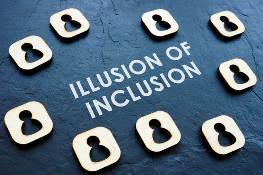 Illusion of Inclusion on the workplace concept. Wooden figures.