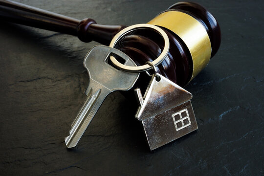 Property litigation and Disputes concept. Key from home and gavel.