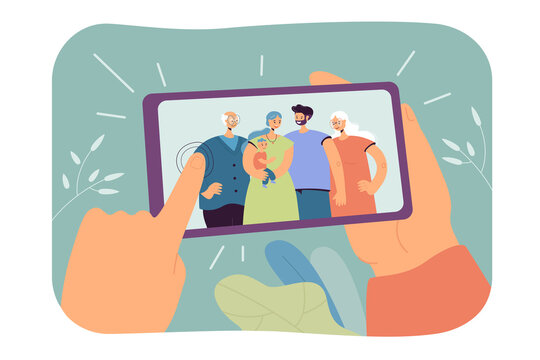 Human hands holding smartphone with family selfie isolated flat vector illustration. Cartoon photo of mom, dad, grandparents and kid making dinner in aprons. Memories and smart technologies concept