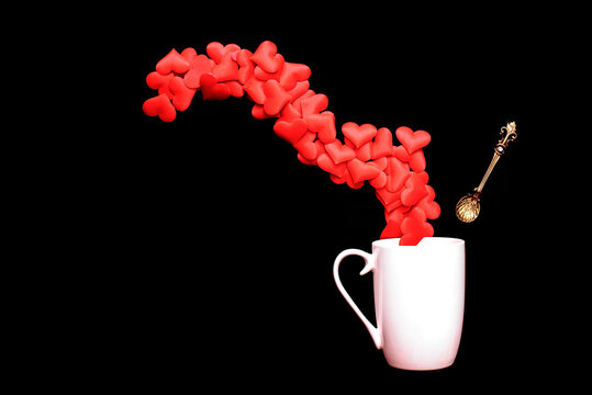 White mug with romantic hearts and a vintage spoon.