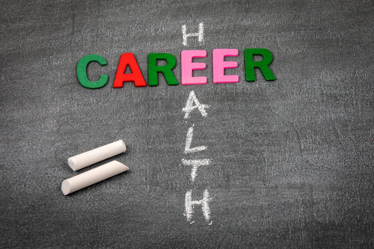 CAREER and HEALTH concept. Colored letters of the alphabet on a dark chalk board