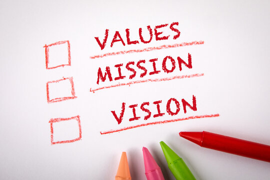 Values, Mission and Vision. Checklist and colored crayons on a white sheet of paper