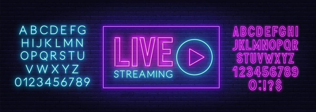 Live streaming neon sign on a brick wall background . Pink and blue neon alphabets.