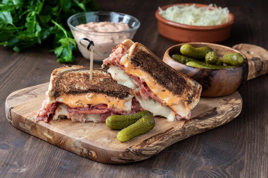 Close up of a grilled cheese Reuben sandwich on marble rye bread ready for eating.