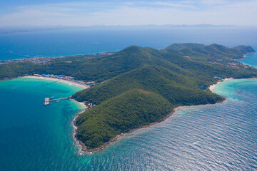 Aerial view of Koh Larn beach, Pattaya with blue turquoise seawater, mountain hills, and tropical...