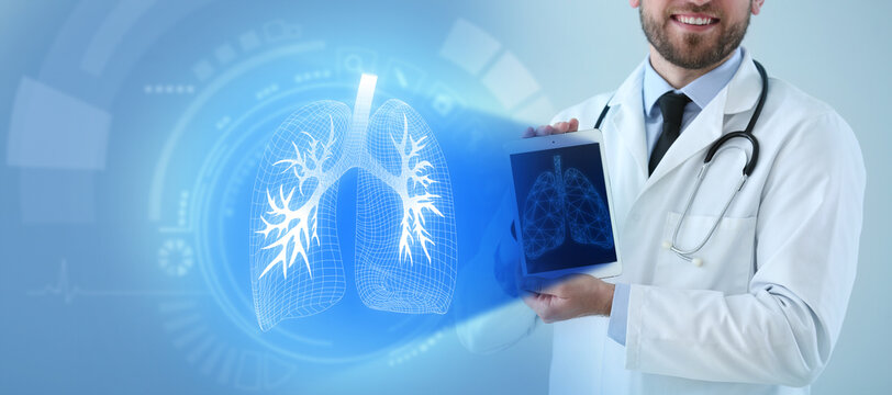 Male doctor holding tablet computer and virtual screen with picture of lungs on color background