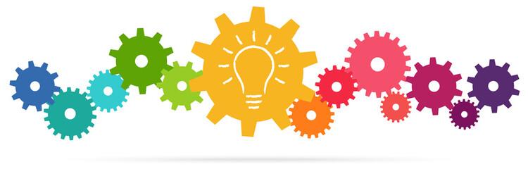 Obraz colored team work gears with light bulb - fototapety do salonu