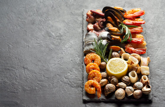 Seafood charcuterie board with shrimp, oysters, fish and octopus