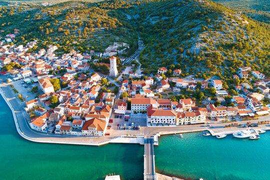 Coastal town of Tisno aerial panoramic view, bridge to island of Murter