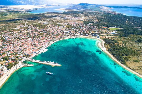 Novalja, Pag island. Idyllic beach and turquoise sea aerial view in town of Novalja