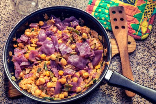 sauteed chickpeas with red cabbage and vegetables. healthy meal