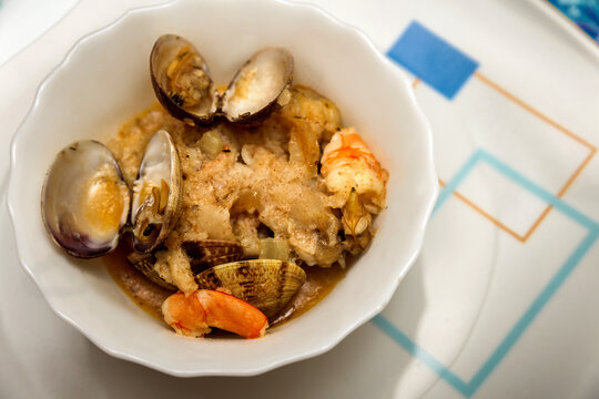 cocktail bowl with clams and prawns in sauce . seafood