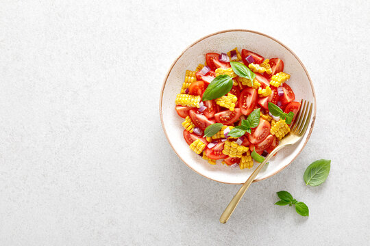 Tomato and corn salad with fresh basil and red onion