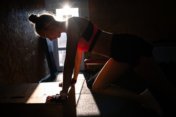 Athletic woman doing fitness workout in the gym. Athlete push ups from the floor