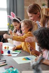 Children and teacher at art class