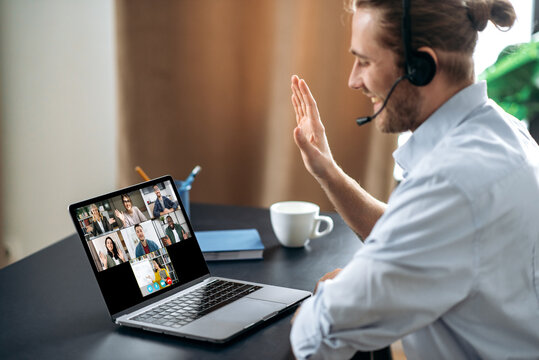 Group brainstorm, online video meeting, virtual conference with multiracial colleagues. Caucasian man communicate with business partners by video call uses laptop and app, work from home