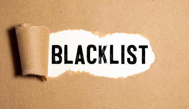 blacklist text on torn paper
