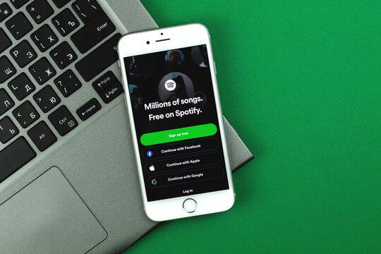 Kharkov, Ukraine - February 22, 2021: Spotify logo on Apple iPhone screen, application for mobile phone for listening music