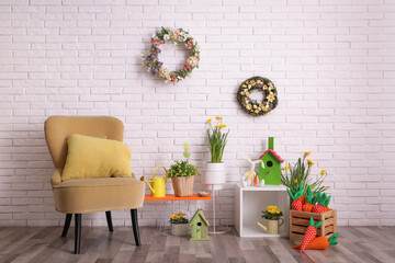 Elegant Easter photo zone with floral decor and armchair indoors