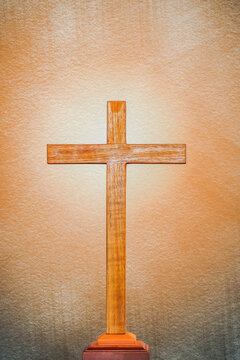 background of wooden cross on bright light flare background