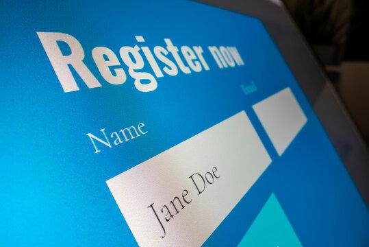 Completing registration form online, placeholder name used