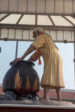 Nashik , India - 21 February 2021, Statue of indian ancient saint sai baba It shows Saibaba cooking food for devotees at Shirdi Nashik Maharashtra......