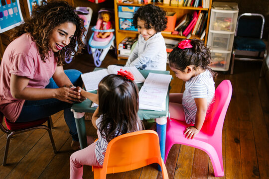 latin children playing in the classroom in Mexico