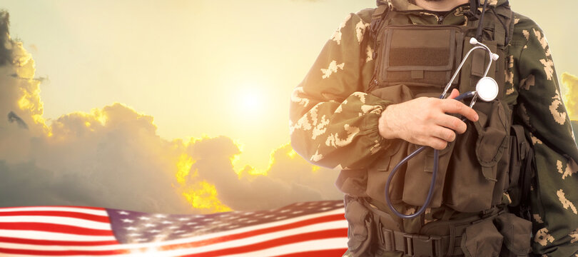 Military doctor and USA flag on sunrise background .Concept National holidays , Flag Day, Veterans Day, Memorial Day, Independence Day, Patriot Day.