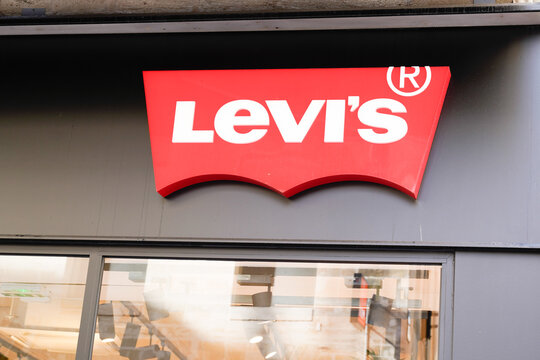 Levi's text brand sign and red Logo front of us Jeans shop fashion boutique of clothing brand levis american store