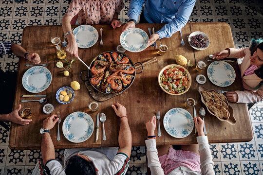 Crop people eating traditional food in restaurant
