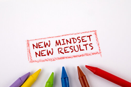 New mindset new results. Colored crayons on a white sheet of paper