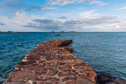 Scenic view of stone pier in the waterfront of Roscoff at evening in summer.