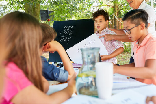 Group of children learns math in summer course