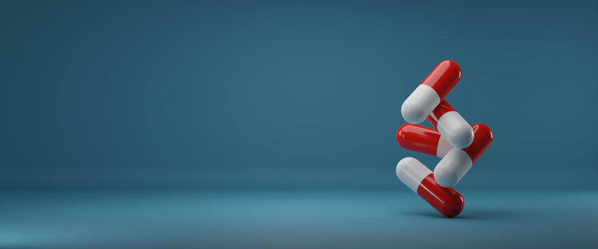 3D render illustration.group of medicine pills and antibiotics on top of each other on blue background.Medical and health care concept.copy space.