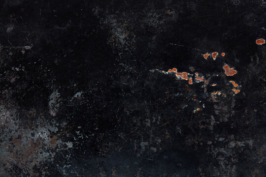 Black, corroded metal texture background with stains