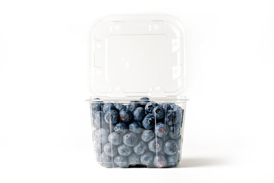 clear blueberry jar, on white background, with open lid, front view