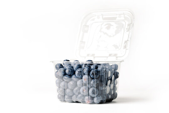 transparent blueberry jar, on white background, with lid ab, side view
